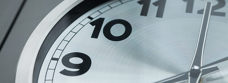 cropped view of analog wall clock